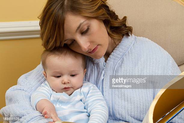 Mother reading to her baby at bedtime