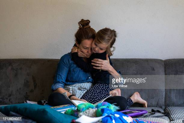 a mother reading to her child while homeschooling - parenting stock pictures, royalty-free photos & images