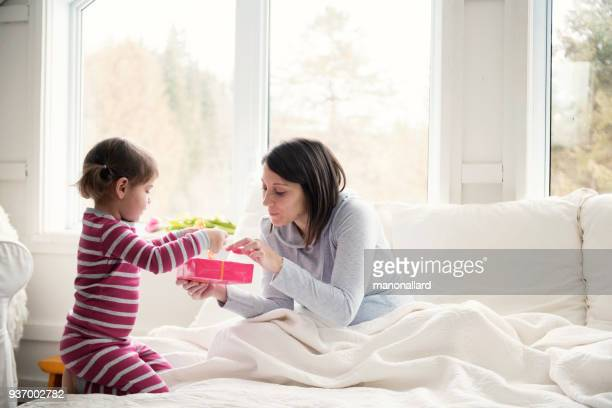 mother receive gifts during mother's day - mother's day stock pictures, royalty-free photos & images