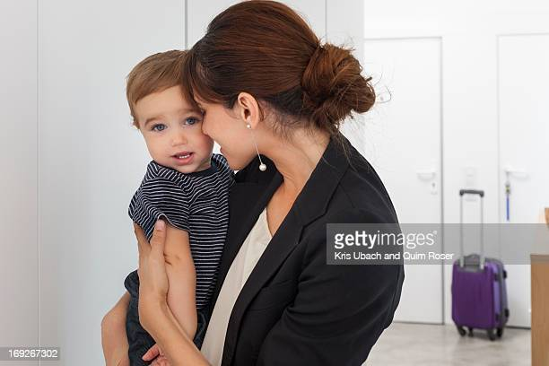 Mother returning from business trip
