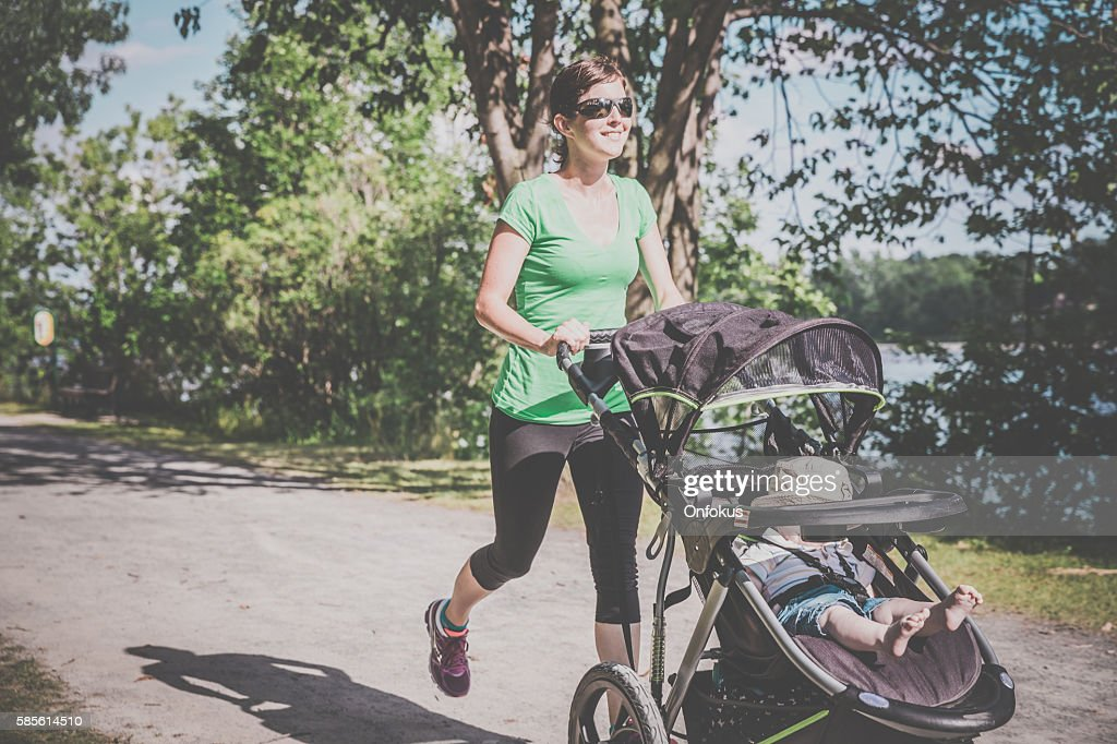 Mother Running Walking With baby Stroller in Park : Stock Photo