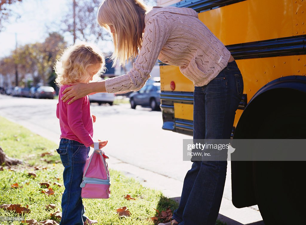 Mother Saying Goodbye to Daughter : Stock Photo