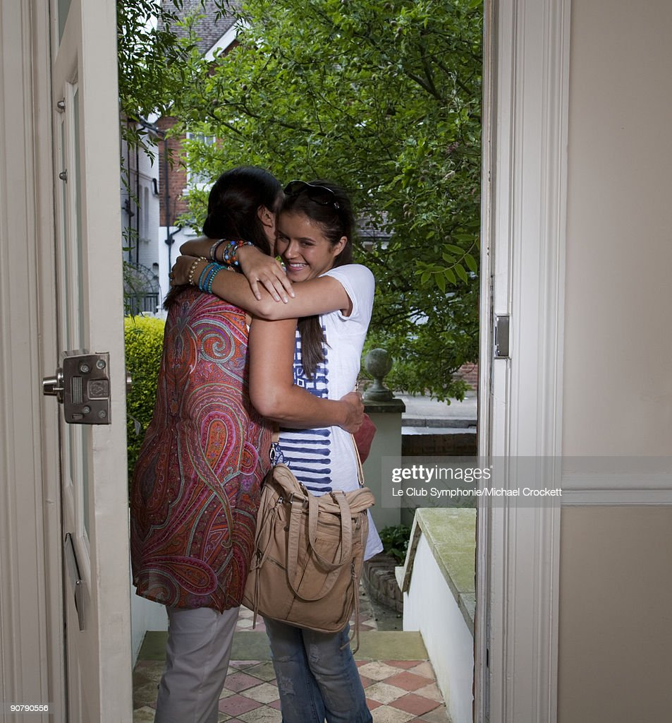 mother saying goodbye to teenage daughter on doors  Stock Photo  sc 1 st  Getty Images & Mother Saying Goodbye To Teenage Daughter On Doors Stock Photo ...