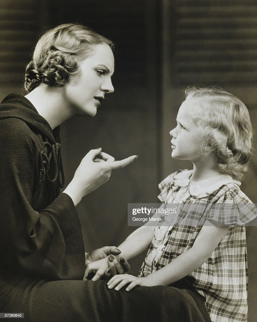 Mother scolding daughter (6-7), (B&W) : Stock Photo