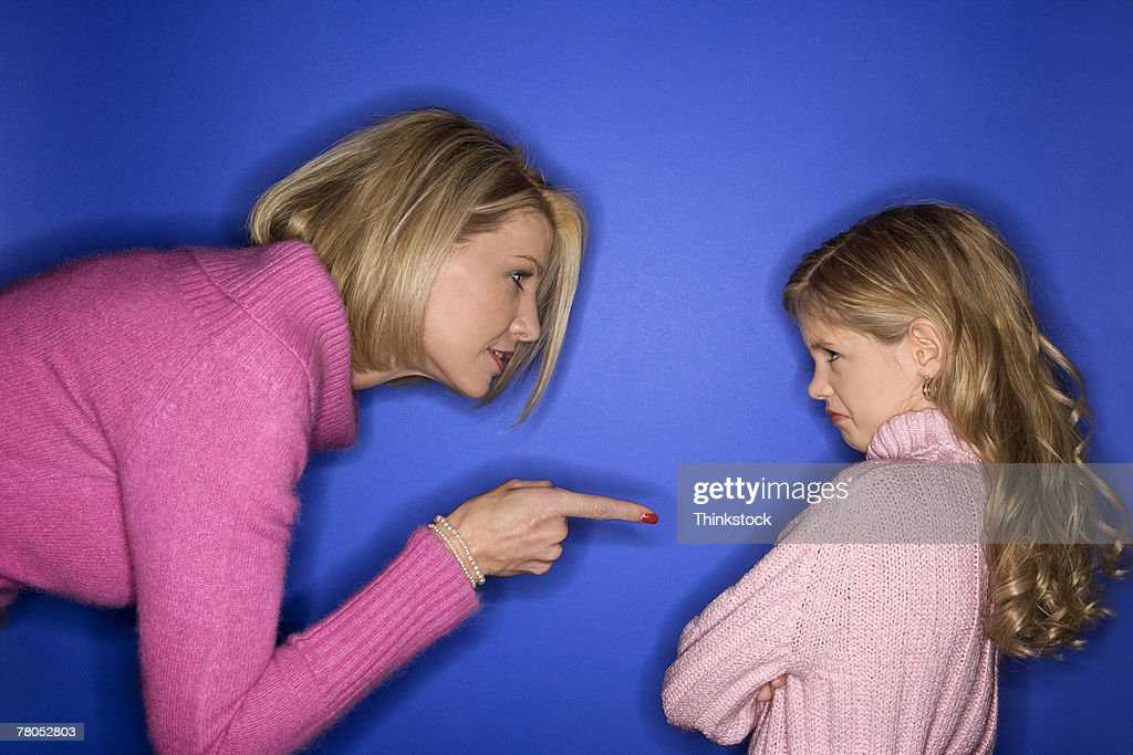 Mother scolding daughter : Stock Photo