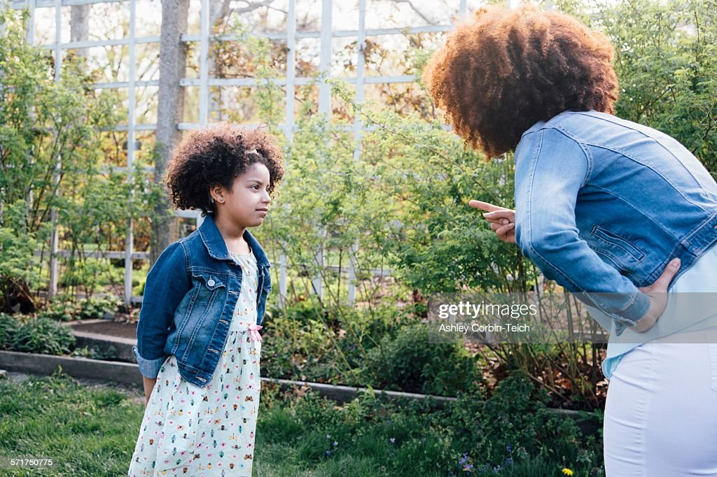 Mother scolding girl, hand on hip, pointing finger : Stock Photo