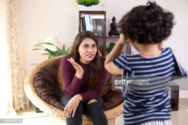 mother scolding her daughter - slapping stock pictures, royalty-free photos & images