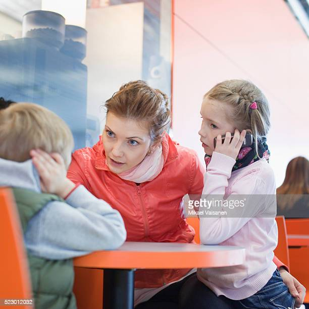 Mother scolding son in food court