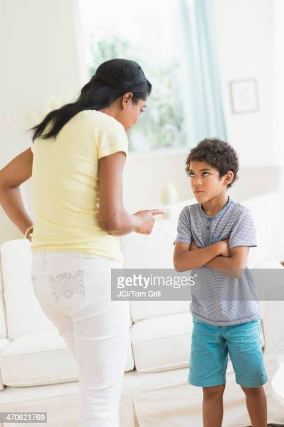 Mother scolding son in living room