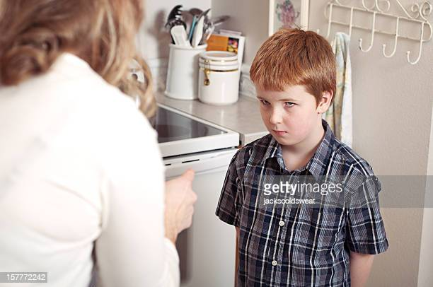 mother scolding son - penalty stock pictures, royalty-free photos & images