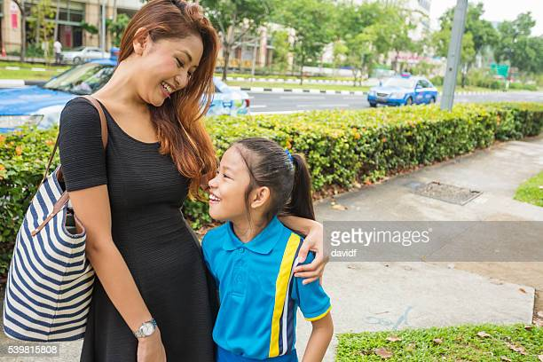 Mother Seeing Her Daughter Off to School