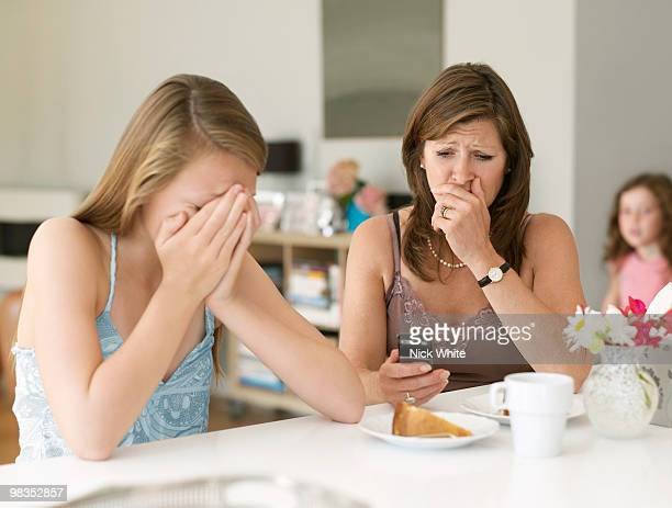 mother sees cyber bullying on cellphone - incidental people stock pictures, royalty-free photos & images
