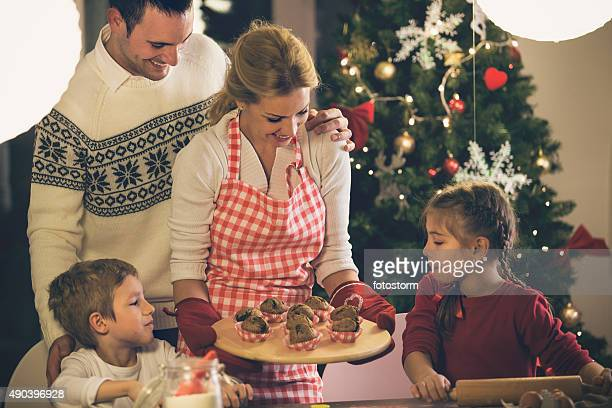 Mother serving muffins o her family for Christmas