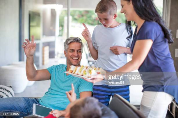 mother serving sandwiches for her family - serving food and drinks stock pictures, royalty-free photos & images