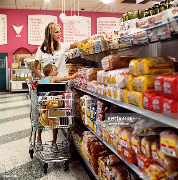 Mother shopping with baby in grocery store