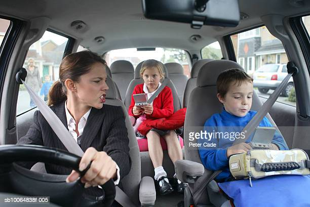 Mother (6-9) shouting at children in car