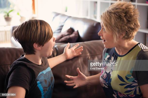 Mother shouting at teenage son
