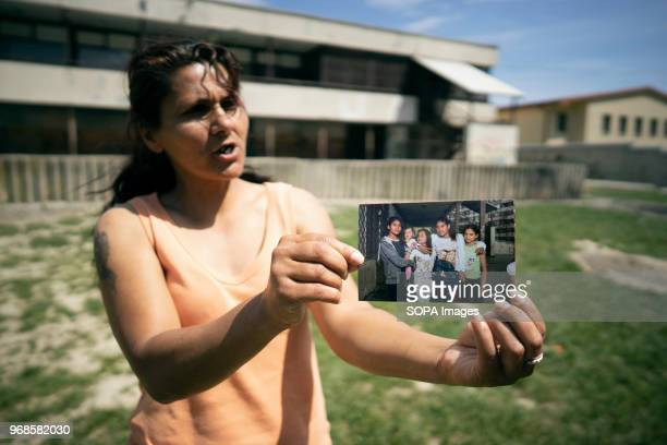 A mother showing a picture of her children Her son lives in the UK where many of the Roma go to find work and send money back home Lunik IX is the...
