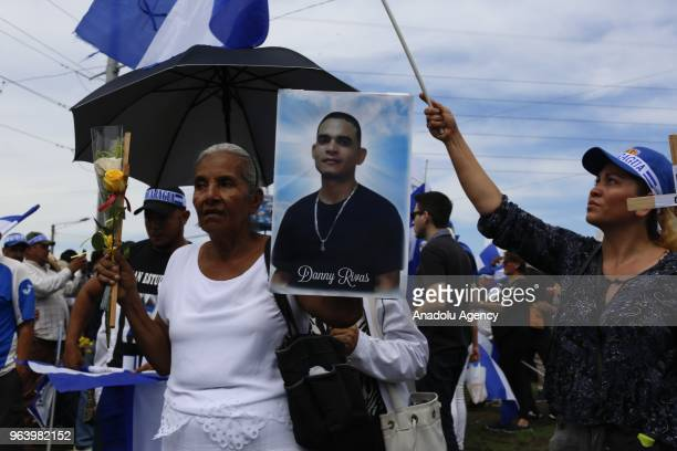 A mother shows a photo of her dead son during the march of mothers' day called in memory of the dead and disappeared during the 42 days of crisis...