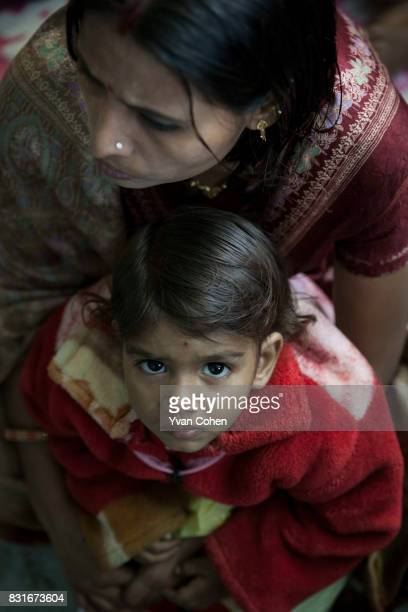 A mother sits with her child at a health center run run by Calcutta Kids in the Fakir Bagan slum area of the city Founded in 2004 Calcutta Kids is a...