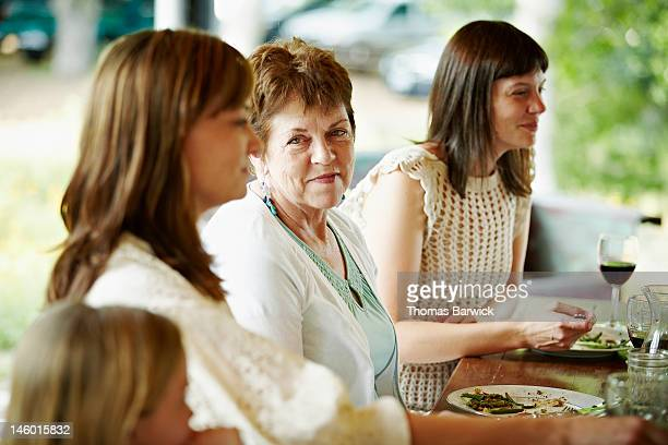 Mother sitting between two daughters at table