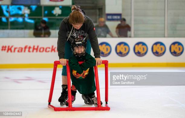 A mother skates with her child in the free skate during Kraft Hockeyville Canada on September 16 2018 at the Lucan Community Memorial Centre in Lucan...