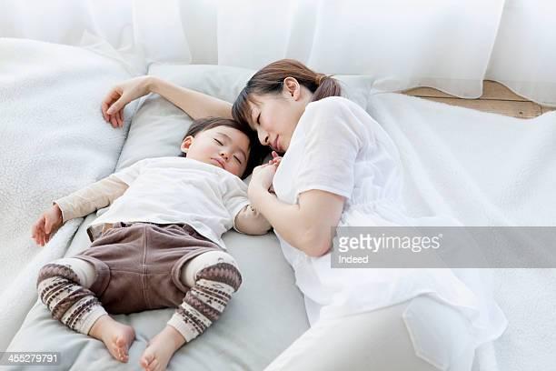 Mother sleeps with baby
