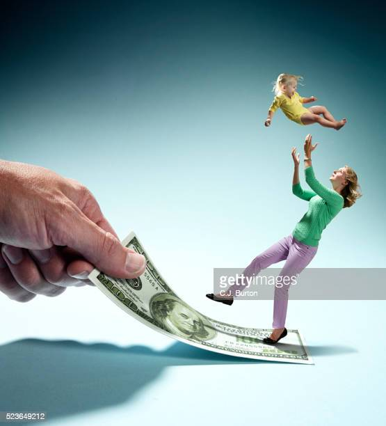 mother slipping on dollar bill, loosing baby (2-3) out of hands - family dollar stock pictures, royalty-free photos & images