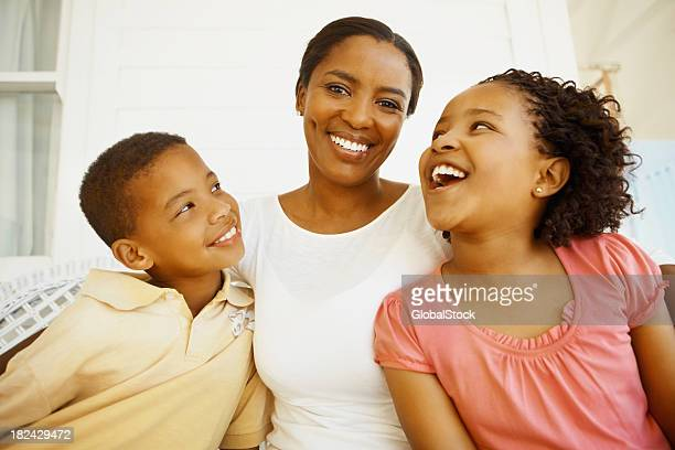 Mother smiling with son and daughter