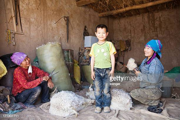 mother, son, and her elder sister - mongolian women stock photos and pictures