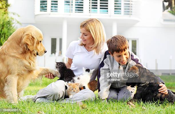 Mother, son and pets.