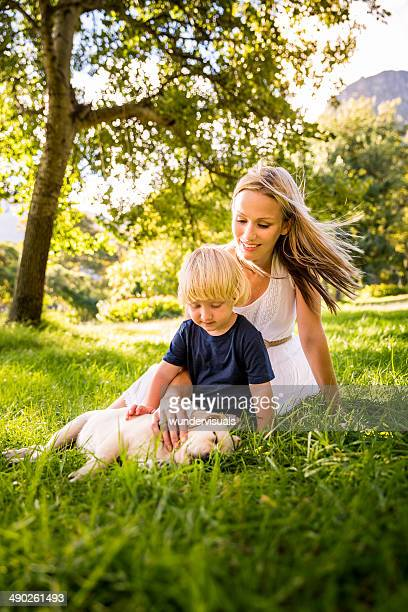 Mother son and puppy in the park
