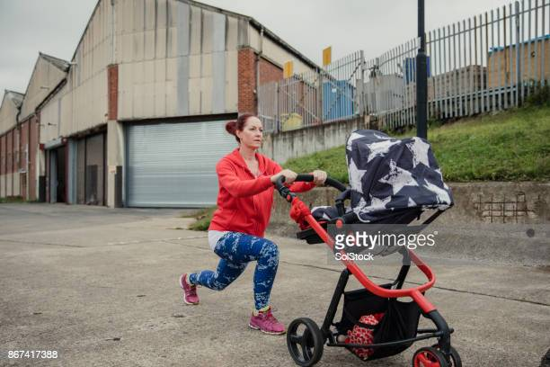 Mother Stretching With Pushchair After Run