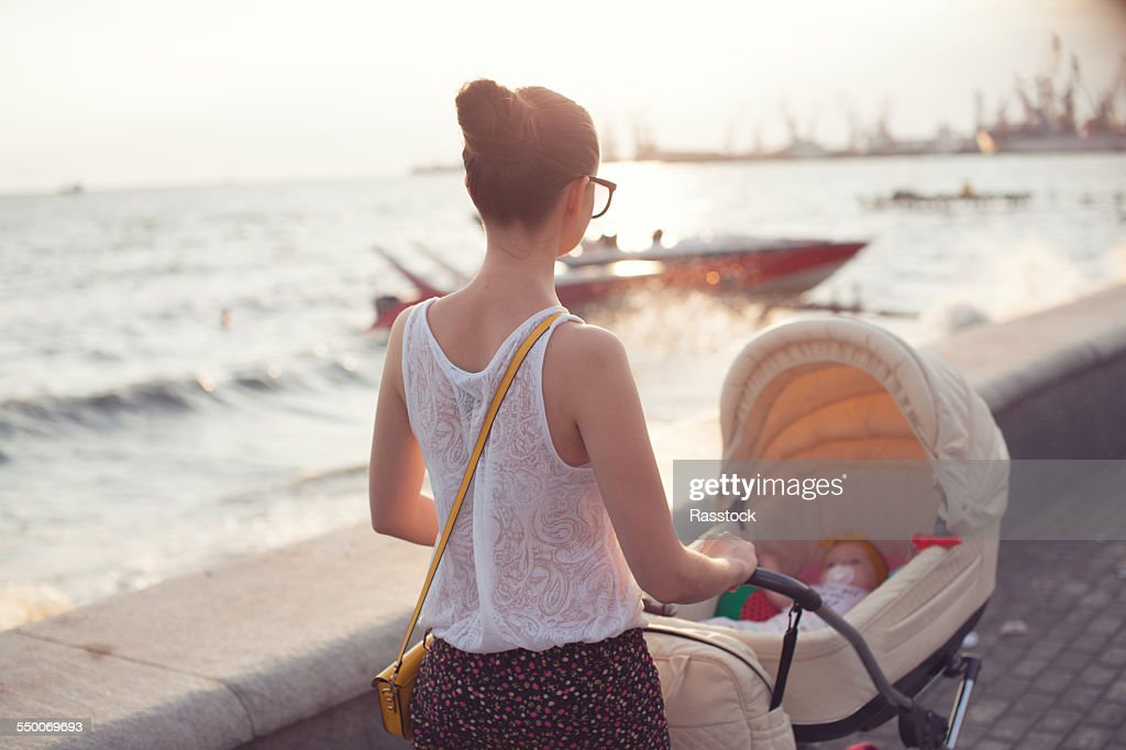 Mother strolling with newborn : Stock Photo