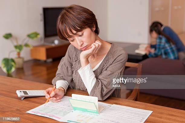 Mother Studying Household Financial Plan