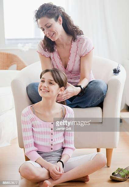 mother styling daughters (10-11 years) hair - 10 11 years stock pictures, royalty-free photos & images
