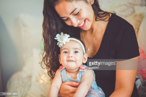 mother sure with sweet 6 month old daughter - puerto rican ethnicity stock pictures, royalty-free photos & images