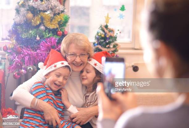 Mother take a photo of children at Christmas morning