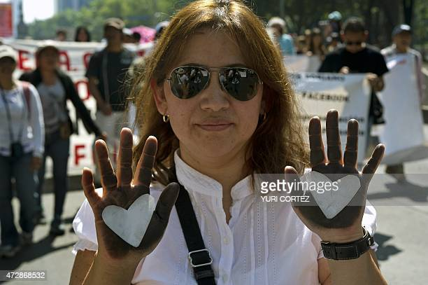 A mother takes part in a protest during the Mother's Day commemoration in Mexico City on May 10 2015 Hundreds of mothers and relatives of missing...