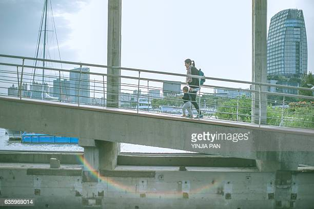 Mother taking baby walking on the slope