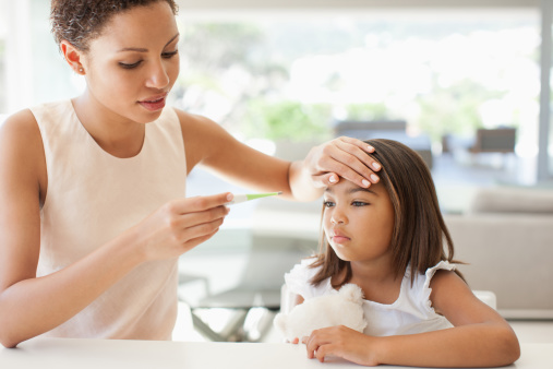 Mother taking daughter's temperature - gettyimageskorea