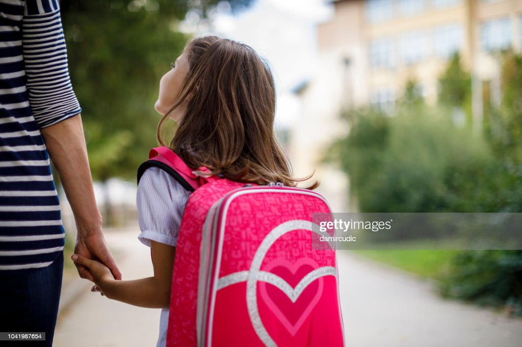 Mother taking her daughter to school : Stock Photo