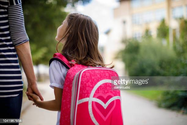 mother taking her daughter to school - school building stock pictures, royalty-free photos & images