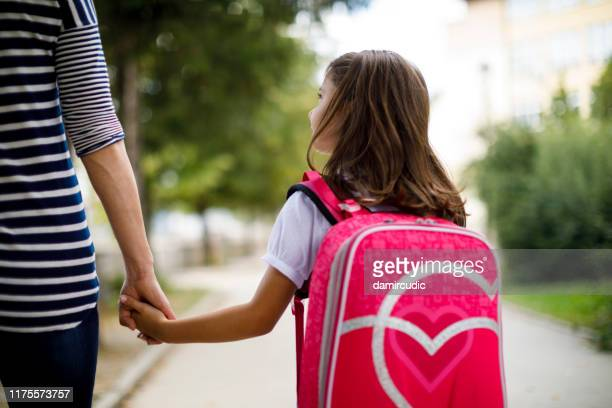 mother taking her daughter to school - unrecognisable person stock pictures, royalty-free photos & images