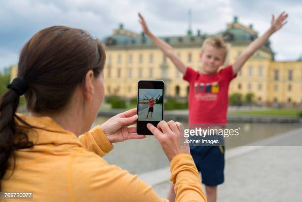 mother taking photo of her son - drottningholm palace stock pictures, royalty-free photos & images