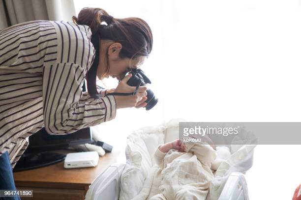 Mother taking pictures of babies.