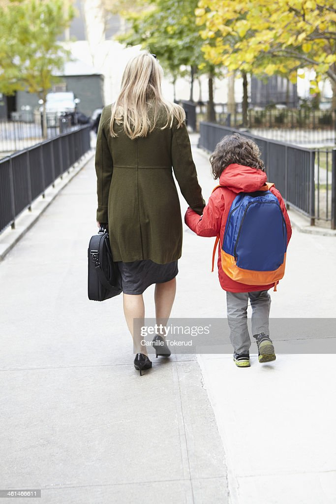 Mother taking son to school : Stock Photo