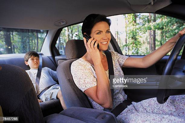 Mother talking on cell phone while driving