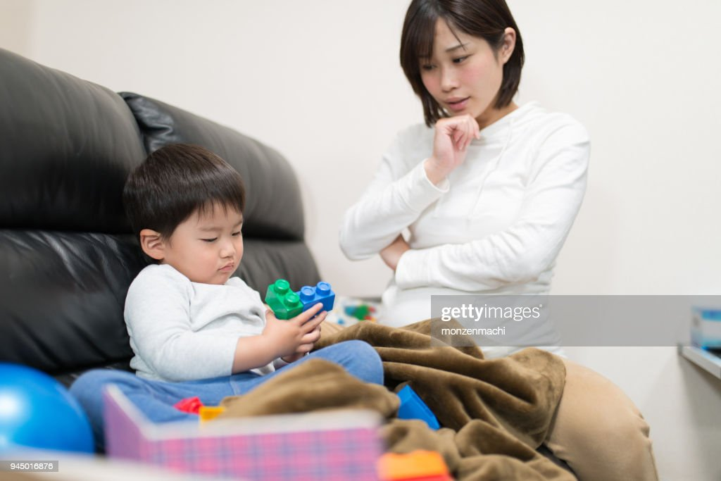 Mother talking to child on sofa : Stock Photo