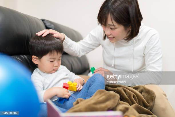 Mother talking to child on sofa